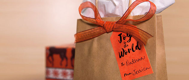 Red adhesive paper used as gift tag sticker